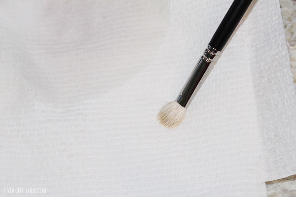 Swipe on a paper towel after spot cleaning makeup brushes