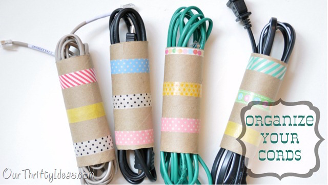Organize extra cords with empty toilet paper rolls and washi tape - love this!