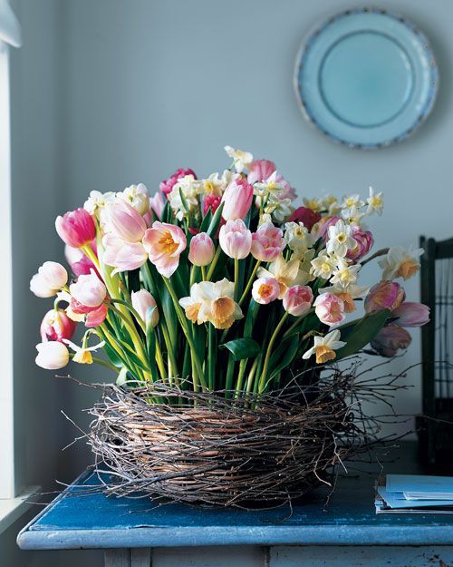 """Beautiful """"nest"""" vase with tulips and daffodils"""