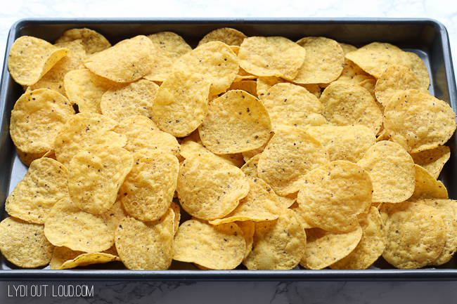 Lay out a bed of tortilla chips for BBQ Pulled Pork Nachos