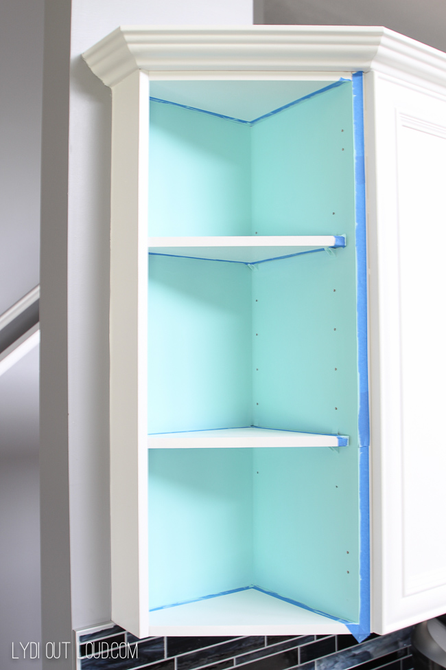 Tape off cabinets and paint base color. & Exposed Kitchen Cabinet Stenciling - Lydi Out Loud