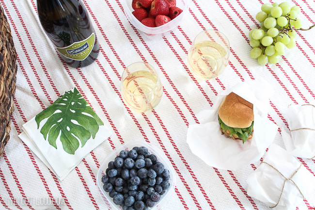 This is a lovely romantic picnic set up with delicious food and wine!