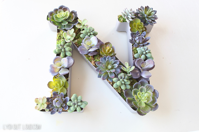 This elegant DIY Succulent Monogram Planter was so easy to make and is a perfect decoration for the top of the kitchen cabinets!