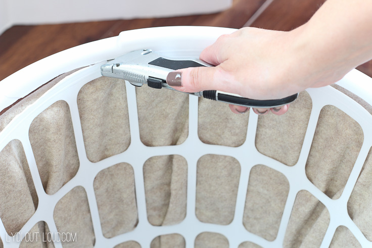 Cut top off of laundry basket with utility knife