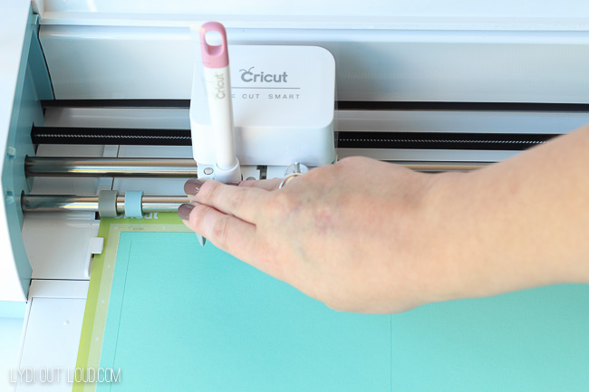 Using the scoring stylus on a Cricut.