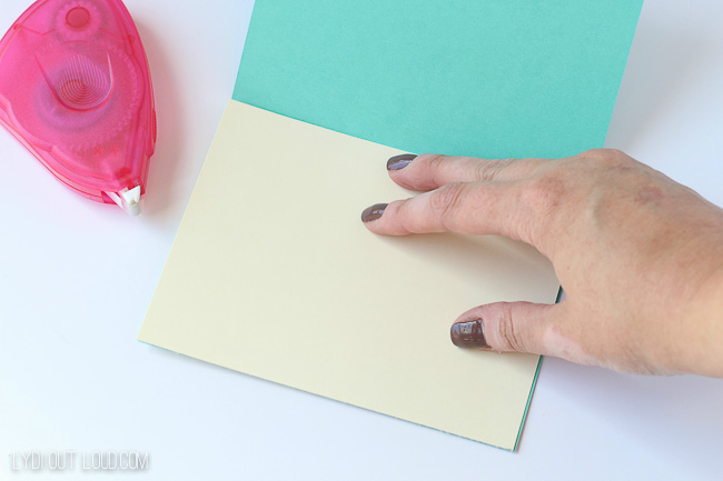 Attach card stock to thank you card so that glitter shows through.