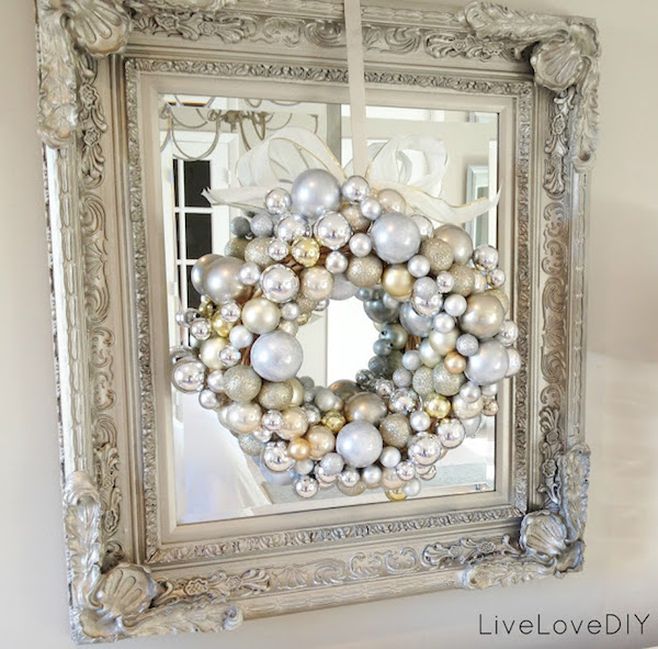 I love the look of this ornament wreath with the mirror behind it!