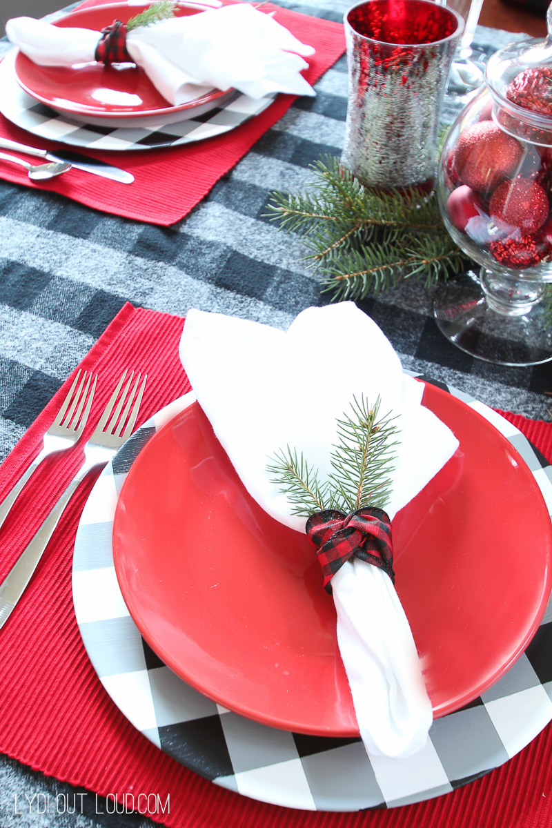 Beautiful Christmas table setting with DIY Buffalo Check Charger Plates