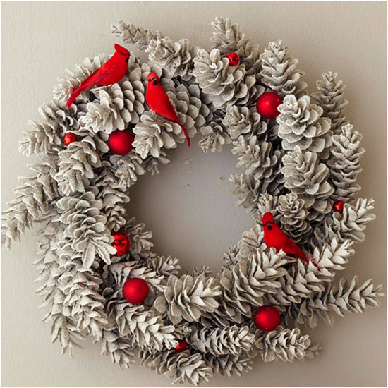 This Pinecone Wreath with Cardinals and Ornaments is so elegant! It would be a perfect contrast on my door!