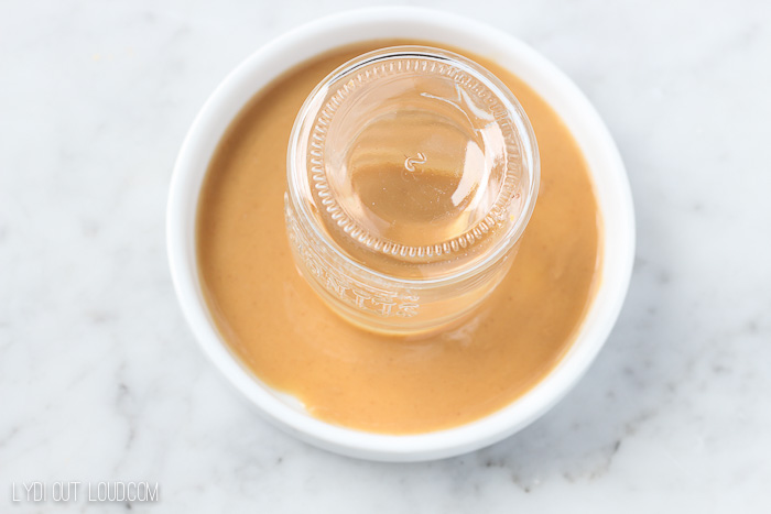 Dip rim of shot glass into peanut butter sauce.