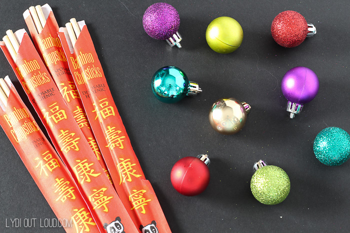 Chopsticks and mini ornaments make the cutest cocktail stirrers!