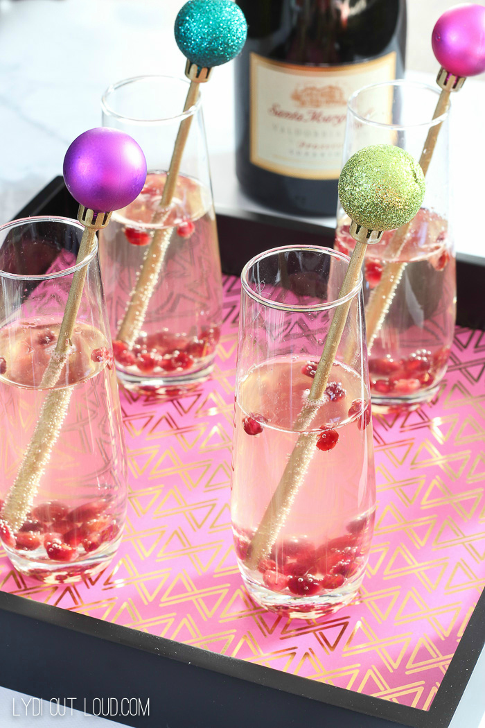 Prosecco with Pomegranate seeds make a festive holiday cocktail!