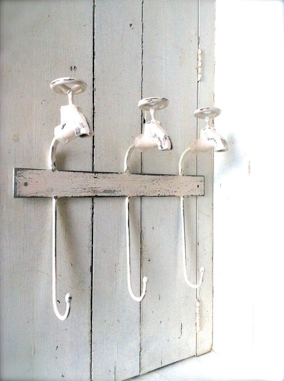 I love this towel rack! The handles are vintage style faucets!