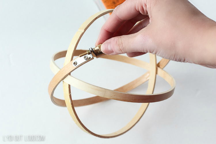 This DIY Terrarium is made out of painted embroidery hoops!