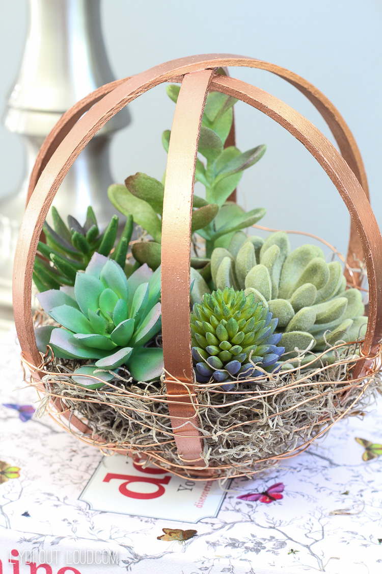 This DIY Terrarium globe is made out of painted embroidery hoops!