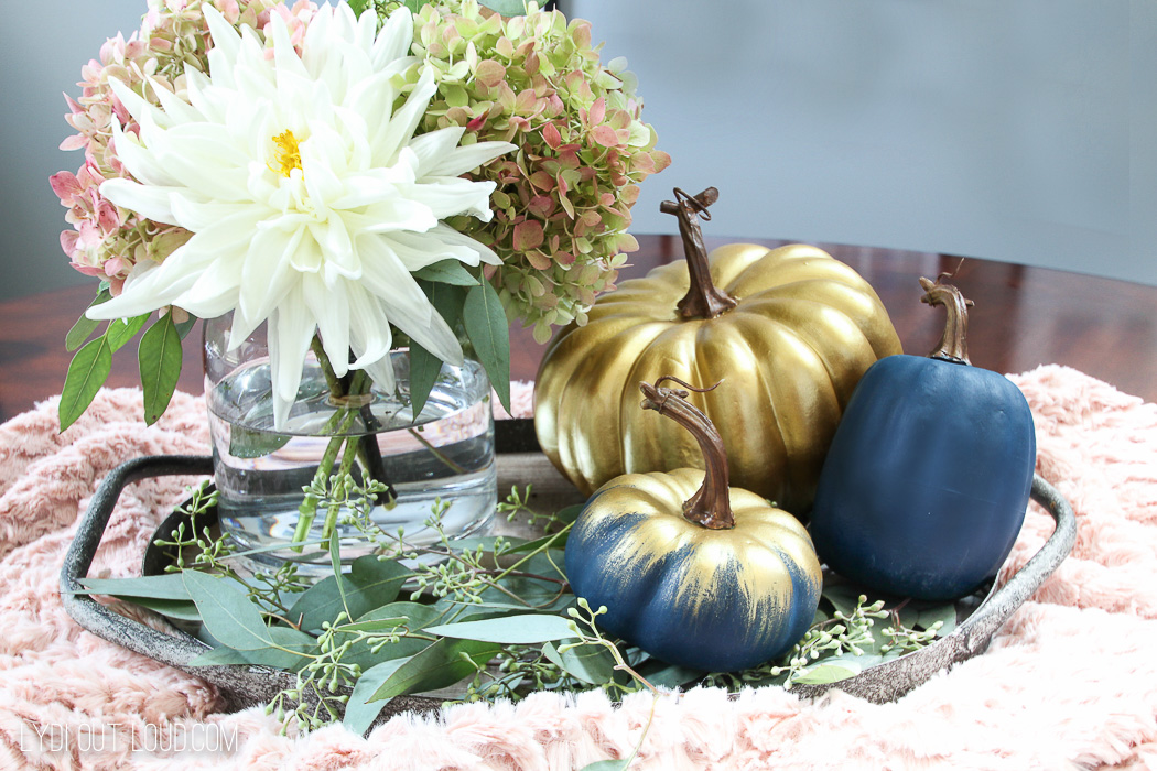 Beautiful Farmhouse Glam Fall Centerpiece with navy and gold pumpkins
