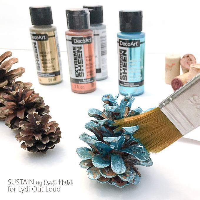 Metallic painted pine cones