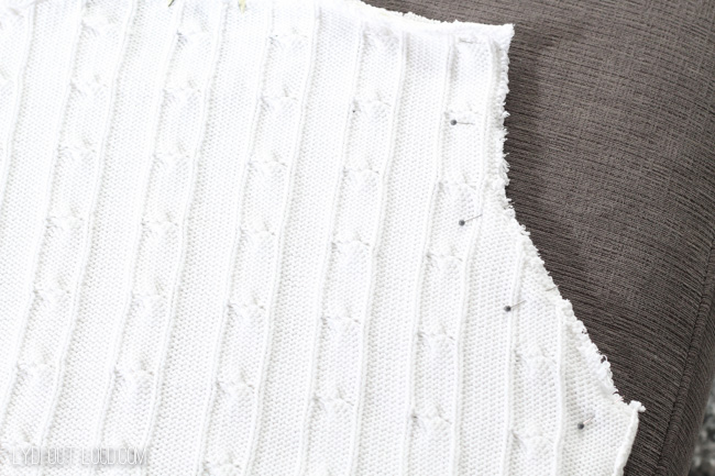 Sew sweater sleeve holes together