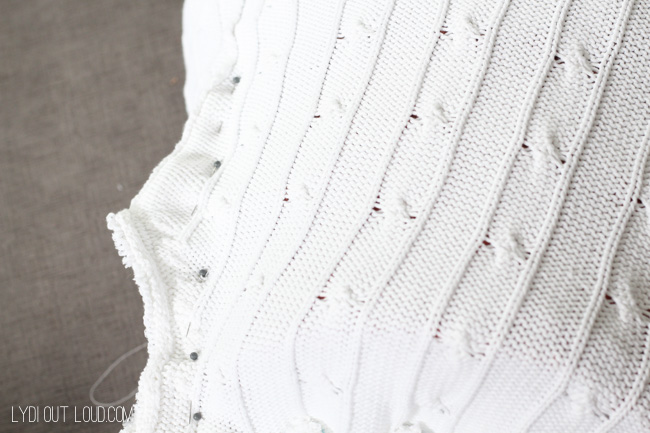 Pin sides of sweater basket