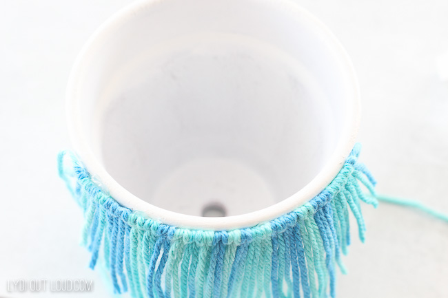Hot glue macrame to clay pot
