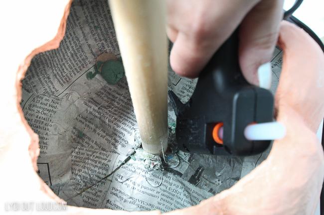Glue dowel rod in pumpkin to make a pumpkin topiary