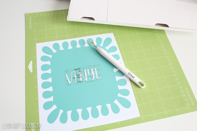 Use transfer tape to transfer words onto vinyl