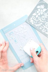 scraper tool with Cricut cutting mat